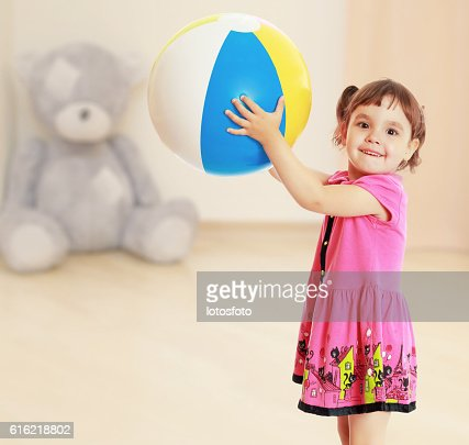 The girl with the ball turned sideways : Stock Photo
