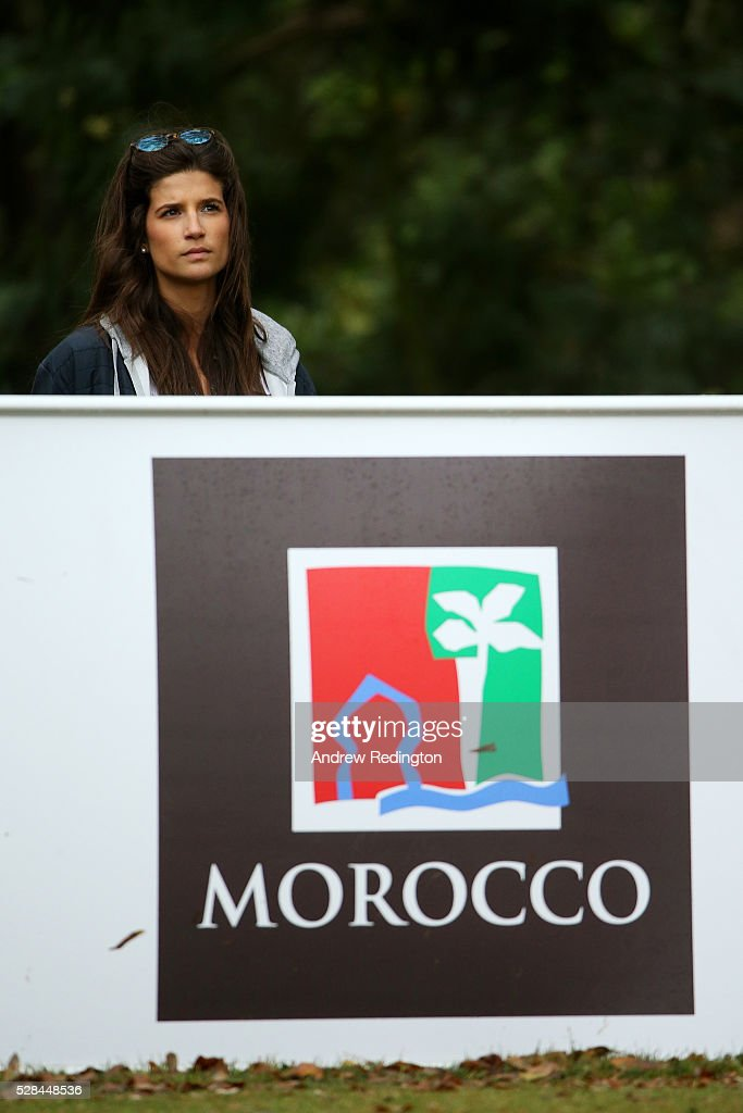 The girlfriend of Alexander Levy of France watches his tee shot on the 11th during the first round of the Trophee Hassan II at Royal Golf Dar Es Salam on May 5, 2016 in Rabat, Morocco.