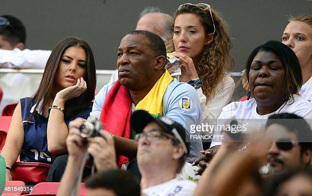 The girlfriend of France's midfielder Paul Pogba and his parents attend the round of 16 football match between France and Nigeria at the Mane...
