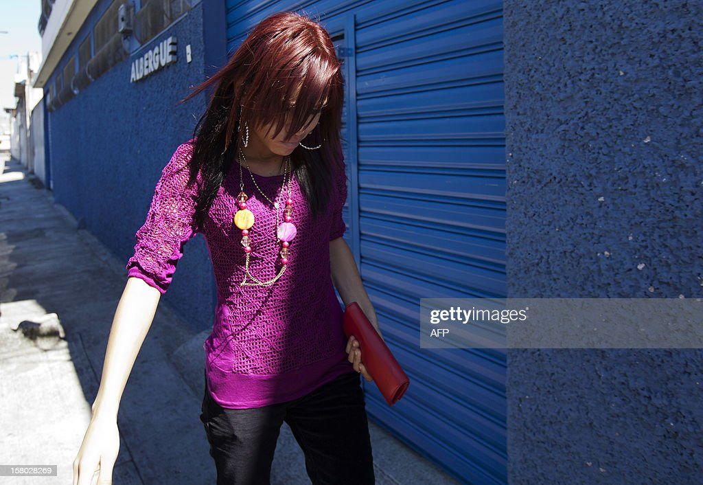 The girlfriend of US internet security pioneer John McAfee, Belize's Samantha Vanega,s walks outside the detention center of the immigration departament in Guatemala City on December 09, 2012. Guatemala refused Thursday to grant asylum to US anti-virus software pioneer John McAfee and said he would be deported back to Belize to answer questions over his neighbor's murder. AFP PHOTO Luis Soto