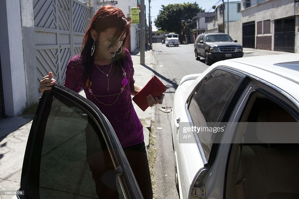 The girlfriend of US internet security pioneer John McAfee, Belize's Samantha Vanegas walks outside the detention center of the immigration departament in Guatemala City on December 09, 2012. Guatemala refused Thursday to grant asylum to US anti-virus software pioneer John McAfee and said he would be deported back to Belize to answer questions over his neighbor's murder. AFP PHOTO Luis Soto