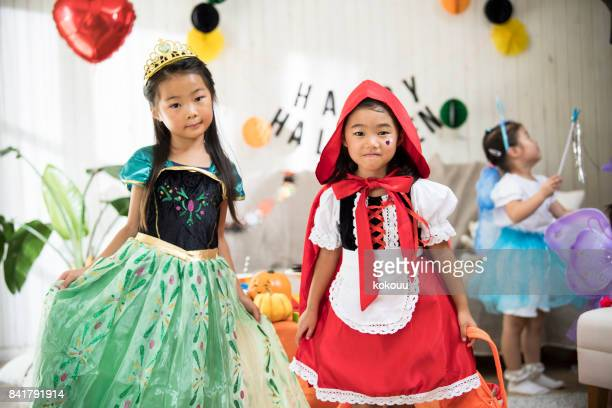 The girls are wearing cute costumes and participating in the party.