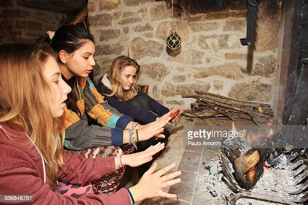 The girls enjoy at fireplace in France