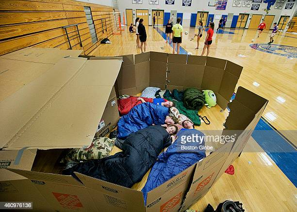 The girls try to sleep in the makeshift boxes as part of a Sleepout Soccerthon run by UK Soccer Development's our Kidz Play 4 Free Project 27 high...