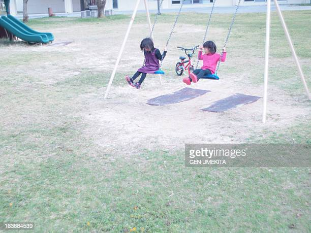 The girls who ride on a swing