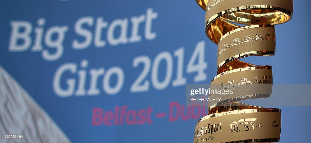 The 'Giro trophy' (R) is pictured during a media launch for the Giro d'Italia at the Titanic Centre in Belfast, Northern Ireland, on February 21, 2013. Another of cycling's biggest races will start in Britain next year after organisers announced on Thursday that the Giro d'Italia will be flagged off in Northern Ireland. The 2014 edition of one of the sport's three Grand Tour races will begin in Belfast on May 10, kicking off three days of action that will also include a stage finishing in Dublin, capital of the Republic of Ireland.