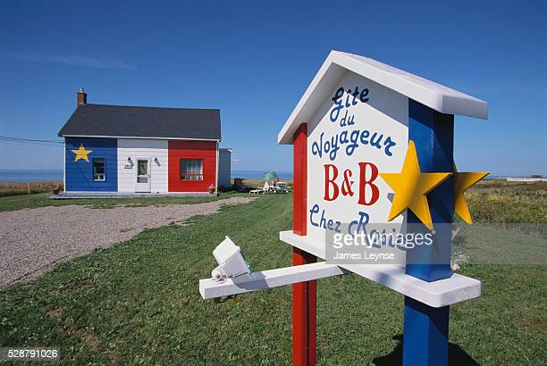 The Gite Du Voyageur 'Chez Rosie' or Rosie Travel Lodge bed and breakfast is painted as the Acadian flag