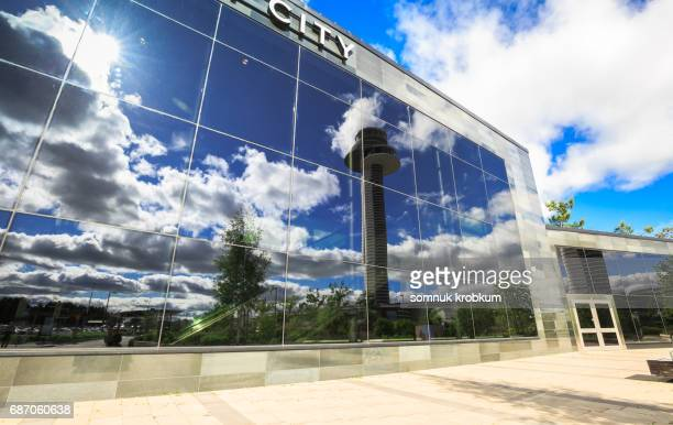 The glass building with reflection of Tower in summer day at Arlanda airport in Stockholm;Sweden.