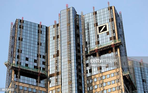 The glass facade of the twin towers of Germany's largest bank Deutsche Bank AG is under construction on March 3 2009 in Frankfurt Germany The city of...