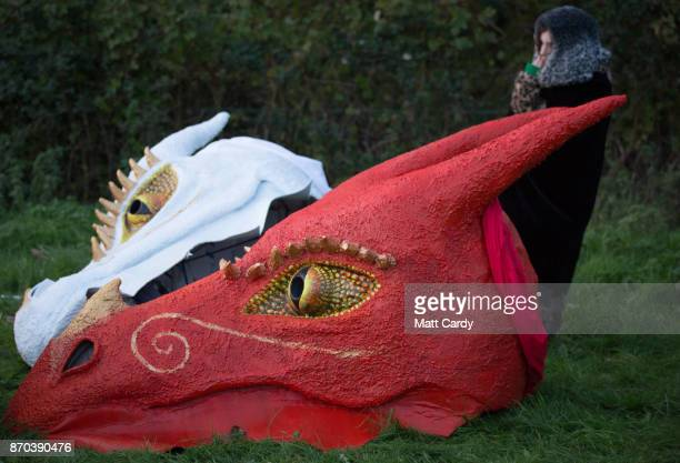 The Glastonbury Dragons heads are seen at a sunset ceremony on the lower slopes of Glastonbury Tor as they celebrate Samhain at the Glastonbury...