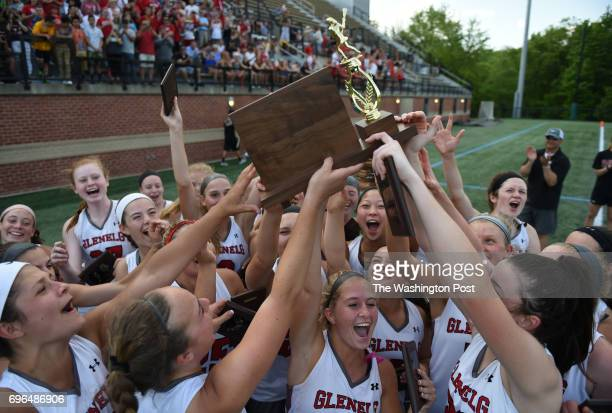 The Glenelg Gladiators hoist the championship trophy after their win over Oakdale in the 3A/2A girls' state final on May 24 2016 in Baltimore MD