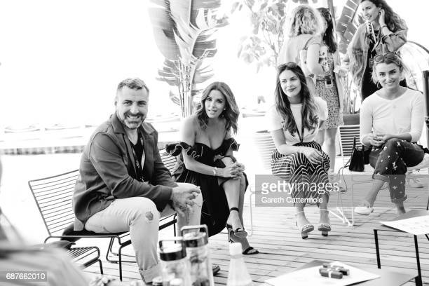 The Global L'Oreal Paris communication VP Remy Averna and Eva Longoria are photographed in the L'Oreal Paris Beach on May 23 2017 in Cannes France