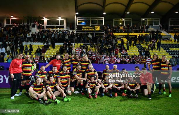 The Gloucester players pose for a picture with their fans following victory during the European Rugby Challenge Cup Semi Final match between La...