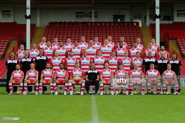 The Gloucester team pose for a team picture during a photocall at Kingsholm Stadium on August 22 2013 in Gloucester England