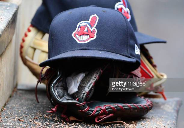 The glove and hat of Cleveland Indians First base Carlos Santana sit on a dugout step during game 1 of a MLB splitdoubleheader between the Minnesota...