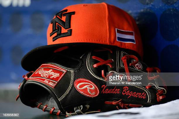The glove and hat of Xander Bogaert of the Netherlands is seen during the semifinal of the World Baseball Classic at ATT Park on March 18 2013 in San...