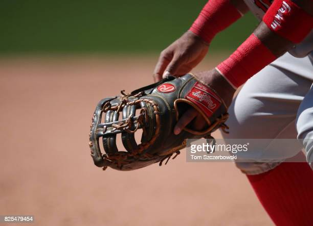 The glove of Luis Valbuena of the Los Angeles Angels of Anaheim as he prepares to field his position at first base during MLB game action against the...