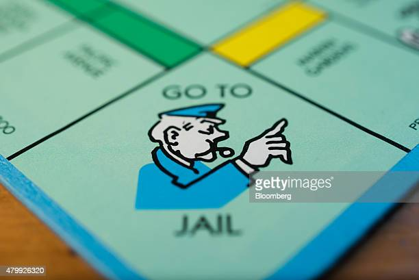 The 'Go To Jail' square is seen on a Hasbro Inc Monopoly board game arranged for a photograph taken with a tiltshift lens in Oradell New Jersey US on...
