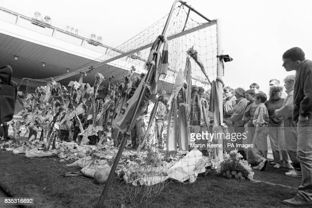 The goal at the Kop end of Anfield bedecked with floral and scarf tributes by Liverpool fans after the stadium was opened to hundreds gathered at the...
