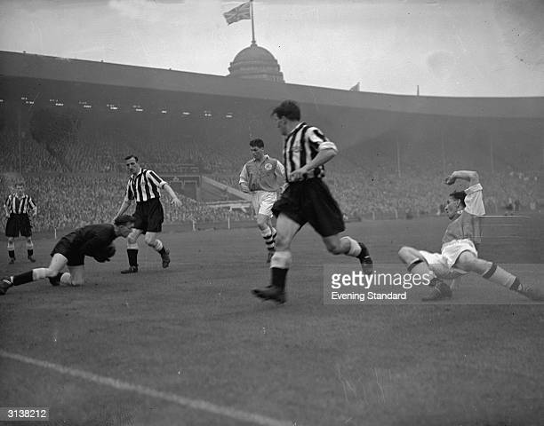 The goalkeeper collects the ball during the FA Cup Final between Arsenal and Newcastle United at Wembley