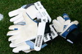 The goalkeeper gloves of Oliver Kahn and Michael Rensing lie on the pitch during the training session at the training camp of Bayern Munich on July...
