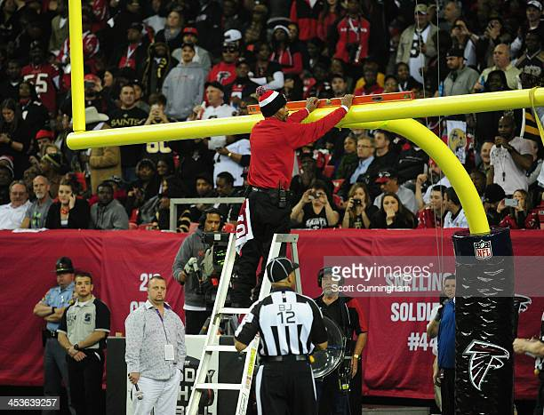 The goalposts are readjusted after a touchdown celebration by Jimmy Graham of the New Orleans Saints during the game against the Atlanta Falcons at...