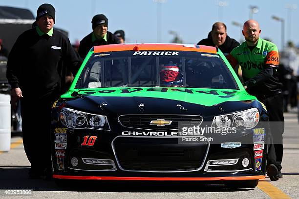 The GoDaddy Chevrolet driven by Danica Patrick is pusedht through the garage area during practice for the NASCAR Sprint Cup Series 57th Annual...