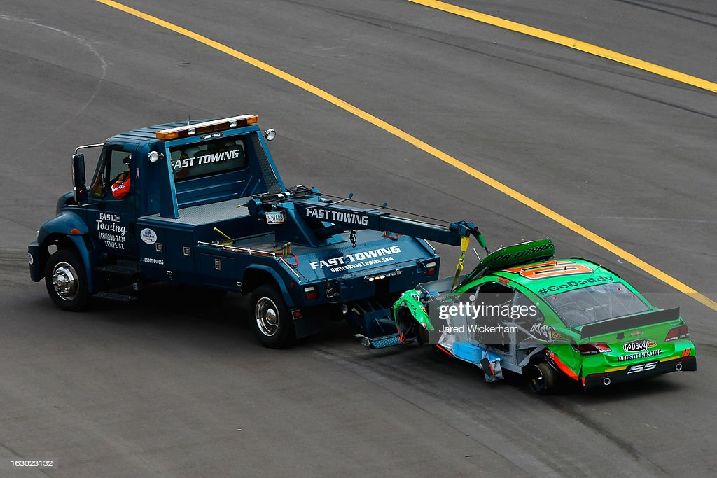 The GoDaddycom Chevrolet driven by Danica Patrick is towed off the track and a wreck during the NASCAR Sprint Cup Series Subway Fresh Fit 500 at...
