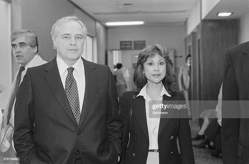 The Godfather actor Marlon Brando arrives at Santa Monica Superior Court with Caroline Barrett Naylen. Naylen is suing novelist James Clavell, author of the book Shogun, for child support for her 10-year-old daughter Petra. Brando appeared in court as he is the child's godfather.