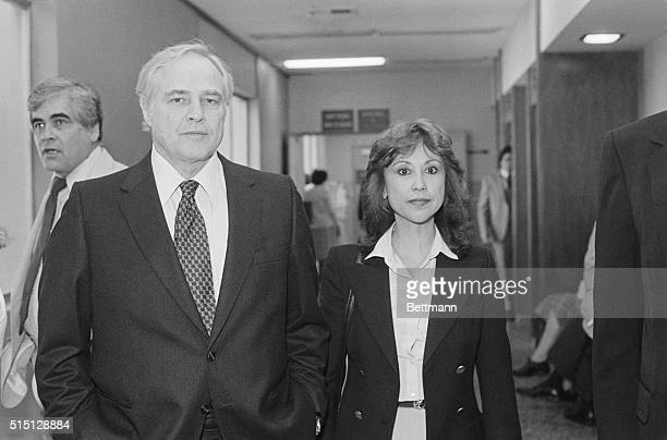 The Godfather actor Marlon Brando arrives at Santa Monica Superior Court with Caroline Barrett Naylen Naylen is suing novelist James Clavell author...