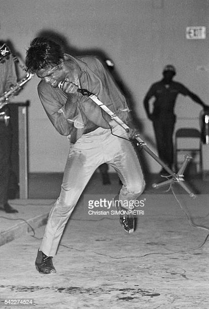 The 'Godfather of Soul' James Brown performs on stage for American troops during the Vietnam War