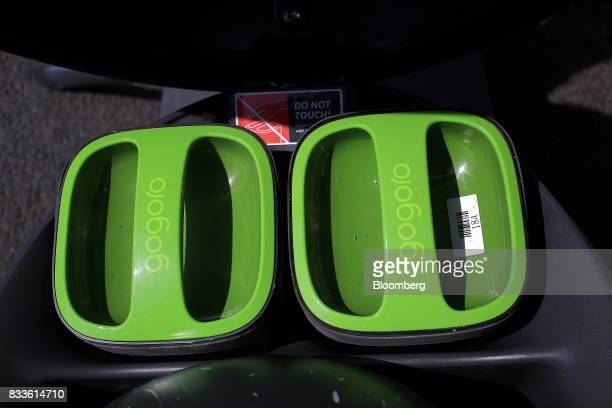 The Gogoro Inc logo sits on battery covers on a Coup eScooter electric hire vehicle operated by Robert Bosch GmbH in Berlin Germany on Thursday Aug...