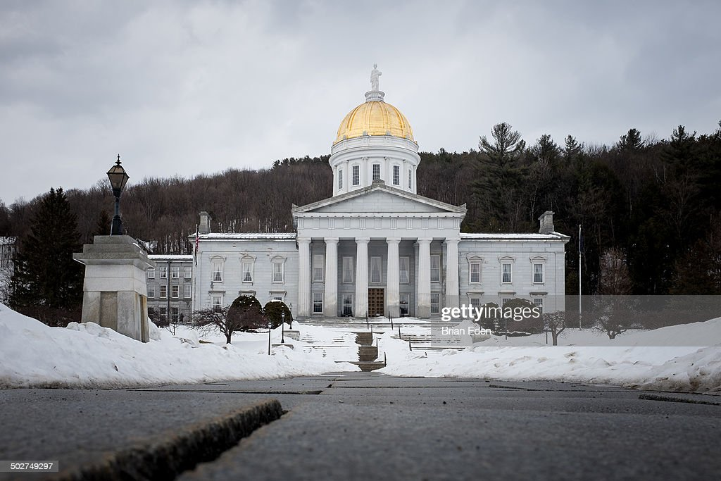 CONTENT] The gold domed Vermont State House in the capital city of Montpelier on a snowy day in winter time There is snow all over the ground
