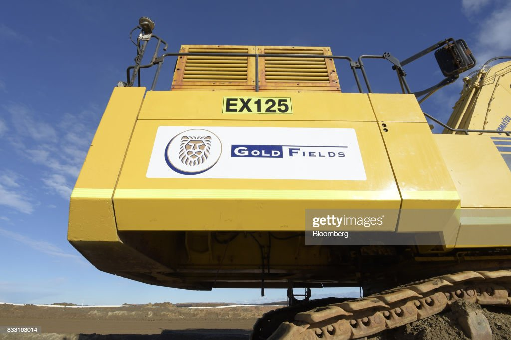 The Gold Fields Ltd. logo is displayed on an excavator at the company's St Ives Gold Mine in Kambalda, Australia, on Wednesday, Aug. 9, 2017. Global gold deals have also slowed, declining to $19.8 billion in 2016 from $22.8 billion a year earlier, according to data complied by Bloomberg.Photographer: Carla Gottgens/Bloomberg via Getty Images