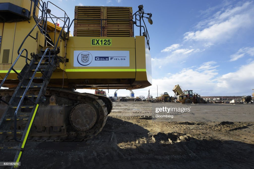 The Gold Fields Ltd. logo is displayed on an excavator in a workshop area of the company's St Ives Gold Mine in Kambalda, Australia, on Wednesday, Aug. 9, 2017. Global gold deals have also slowed, declining to $19.8 billion in 2016 from $22.8 billion a year earlier, according to data complied by Bloomberg.Photographer: Carla Gottgens/Bloomberg via Getty Images