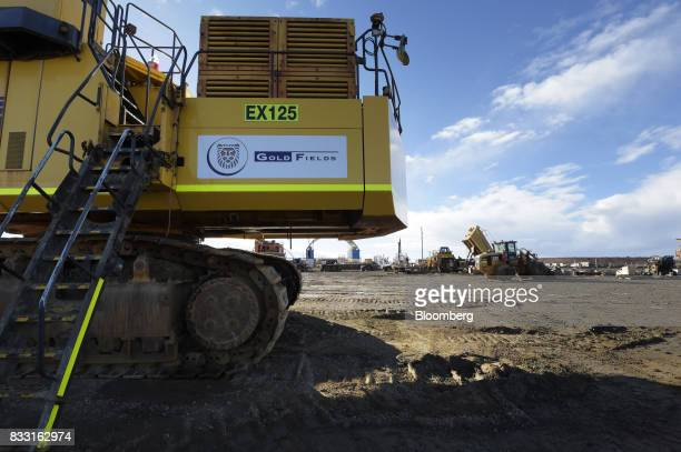 The Gold Fields Ltd logo is displayed on an excavator in a workshop area of the company's St Ives Gold Mine in Kambalda Australia on Wednesday Aug 9...