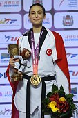 The gold madelist Irem Yaman of Turkey poses with Turkish flag after winning the womens 62 kg final match of WTF World Taekwondo Championships 2015...
