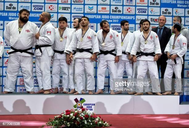 The gold medal winning Georgian men's team including Amiran Papinashvili Vazha Margvelashvili Lasha Shavdatuashvili Zebeda Rekhviashvili Beka...