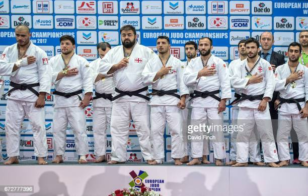 The gold medal winning Georgian men's team stand respectfully for their national anthem The team consisted of Vazha Margvelashvili Lasha...