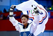 The gold medalist Chia Chia Chuang of Taiwan celebrates as she carries the Taiwan flag after winning the women's 67 kg final match of WTF World...