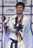 The gold medalist Chia Chia Chuang of Taiwan poses after winning the women's 67 kg final match of WTF World Taekwondo Championships 2015 at the...