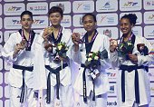 The gold medalist Chia Chia Chuang of Taiwan the silver medalist Nur Tatar of Turkey the bronz medalists Paige Mc Pherson of United States and...