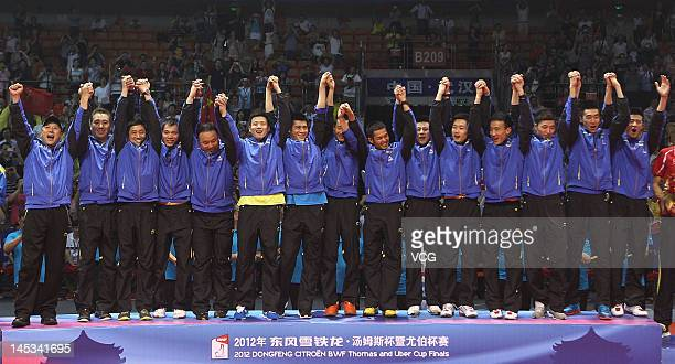 The gold medalist Chinese badminton team pose on the podium during the award ceremony of the Thomas Cup world badminton team championships at Wuhan...