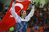 The gold medalist Irem Yaman of Turkey celebrates as she carries the Turkey flag after winning the women's 62 kg final match of WTF World Taekwondo...