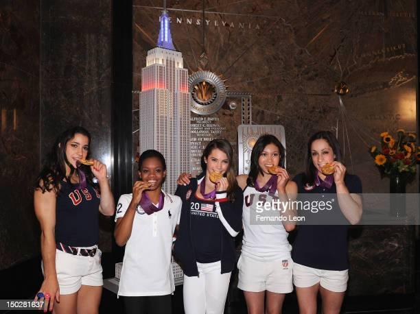 The gold medalwinning US Women's Gymnastics Team Aly Raisman Gabby Douglas McKayla Maroney Kylas Ross and Jordyn Wieber light The Empire State...