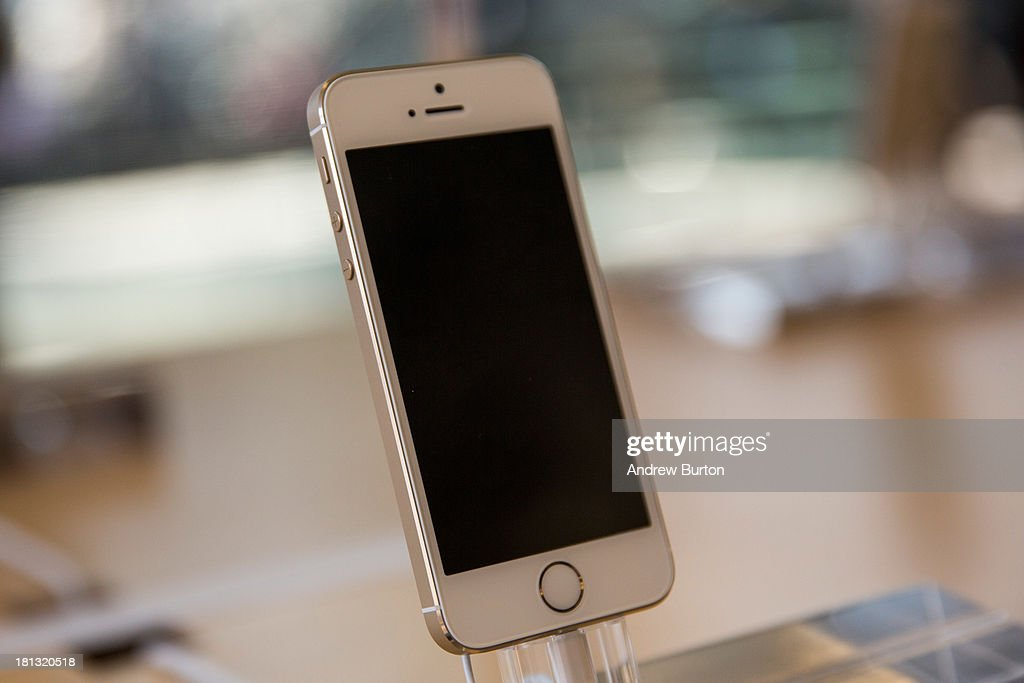 The gold version of the iPhone 5S is displayed at an Apple store on September 20, 2013 in New York City. Apple launched two new models of iPhone: the iPhone 5S, which is preceded by the iPhone 5, and a cheaper, paired down version, the iPhone 5C. The Gold version of the phone has reportedly become one of the hardest to find and orders are backed-up into October.