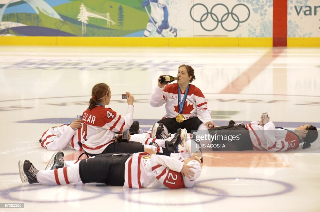 The gold winning Canadian team enjoy a bottle of Champagne following the medal's ceremony in the Woman's Ice Hockey games at the Canada Hockey Place during the XXI Winter Olympic Games in Vancouver, Canada on February 25, 2010. Canada Beat the USA 2-0 to win the gold.