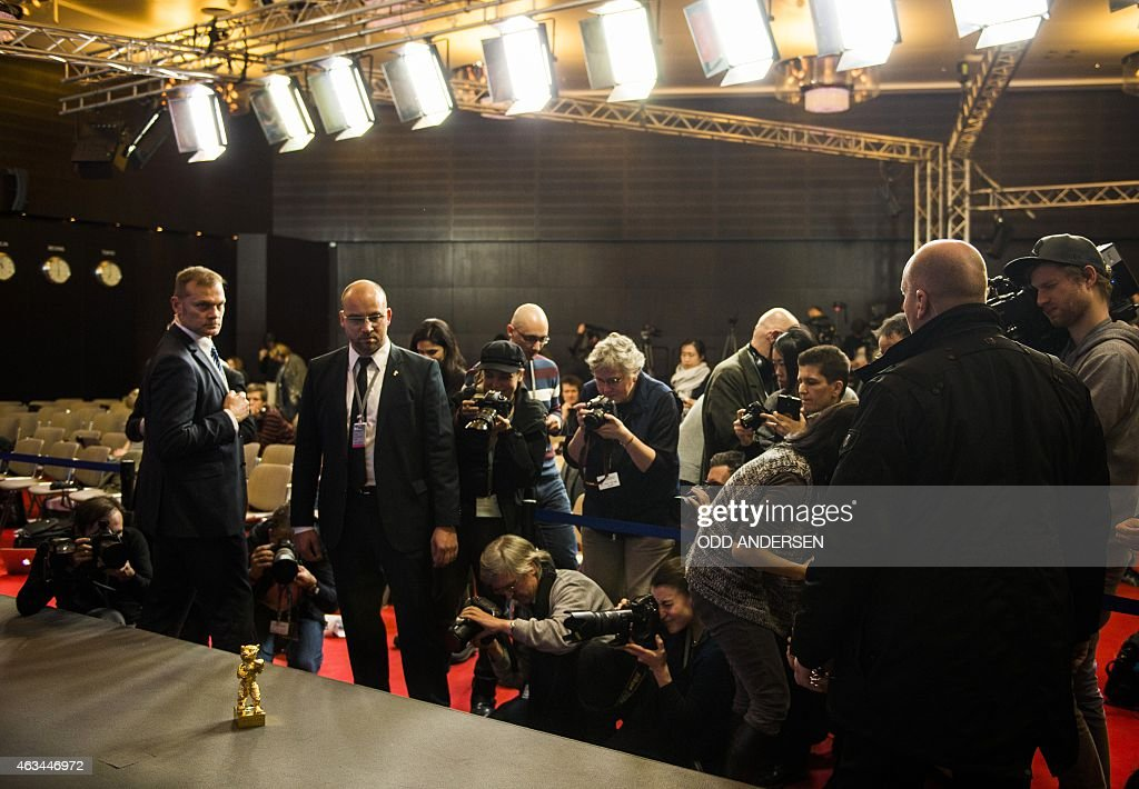 The Golden Bear for Best film trophy, awarded to Iranian dissident director <a gi-track='captionPersonalityLinkClicked' href=/galleries/search?phrase=Jafar+Panahi&family=editorial&specificpeople=621874 ng-click='$event.stopPropagation()'>Jafar Panahi</a> in absentia for his film Taxi, is on display at the award winners press conference after the closing ceremony of the 65th International Film Festival Berlinale in Berlin, on February 14, 2015.