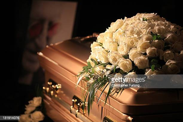 The golden coffin of Sir Jimmy Savile lays in state in the Queens Hotel in Leeds on November 8 2011 in Leeds England Members of the public and fans...