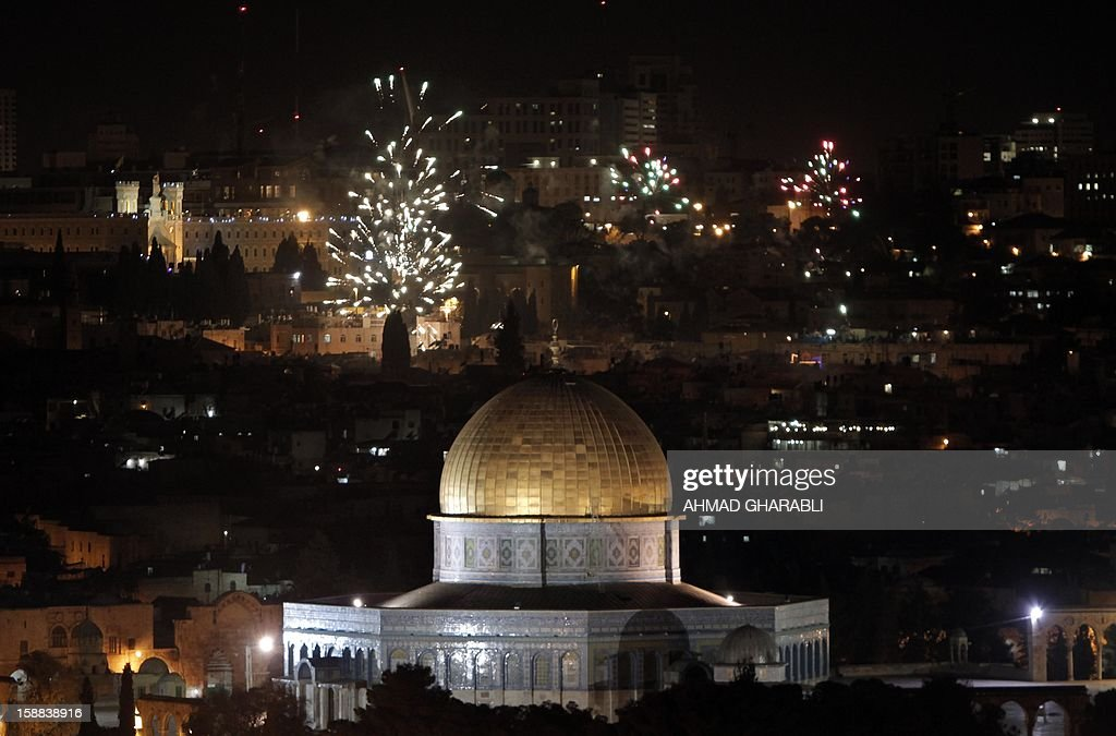 The golden dome of the Dome of the Rock, Islam's third holiest place and part of the al-Aqsa Mosque complex, is seen as fireworks light the skies of Jerusalem to mark the new year on January 1, 2013.